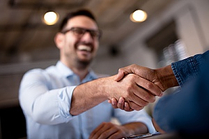 local business owner shaking hands with the owner of an IT security solutions firm