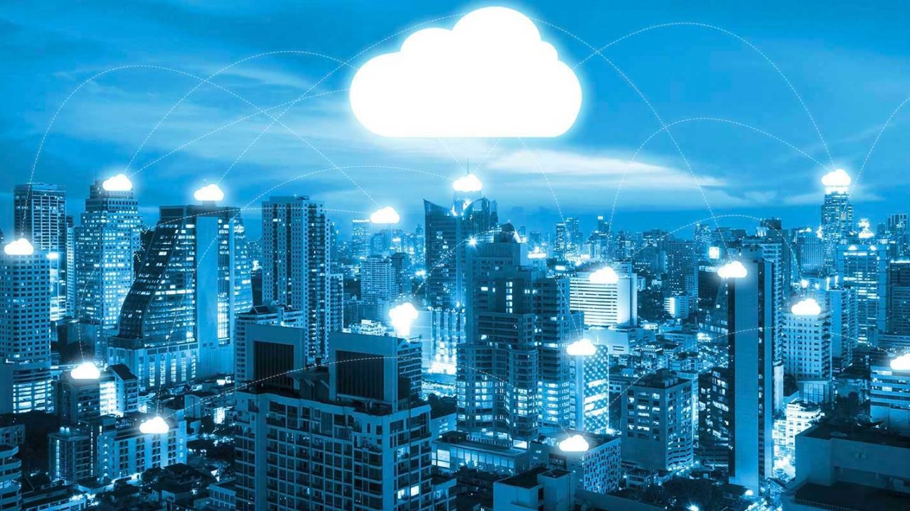 information technology cloud over a cityscape view showing the wide reach of cloud services