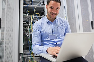 a happy it professional installing a network for a brooklyn new york business
