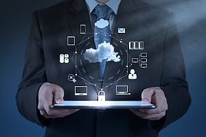 man holding a tablet showing the different cloud services available today
