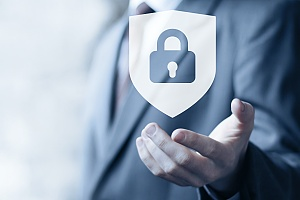 business man holding a lock logo in the palm of his hand representing effective it security services