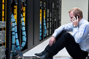 client on the phone with it help desk to assist with network installation in new jersey