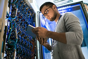 it security services worker tending to network cabling at a client office