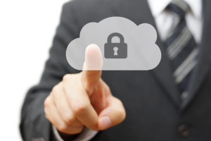 man pointing to a cloud with a lock in it representing it security compliance in cloud services