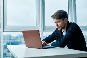 men looking on his computer