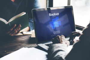 consultant of a managed IT services firm backups the clients data