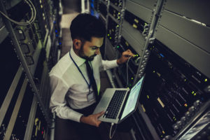 managed IT services consultant configures the server with the computer