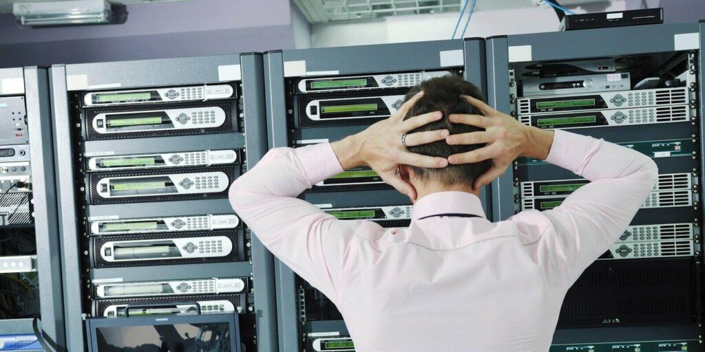 Data Recovery Services- Upset Man Looking at Servers