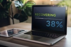 Laptop Displaying the Recovering Process Bar