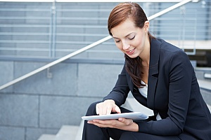 a business woman reading an eBook about disaster recovery