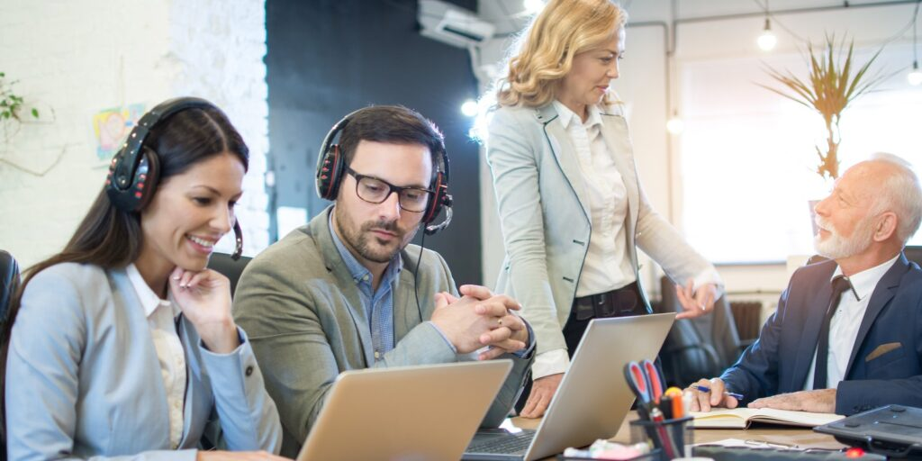 Questions to Ask Your Managed IT Service Provider- Business Persons Working Together
