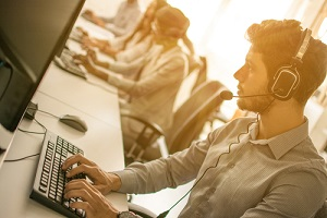 support staff speaking with head set in modern office