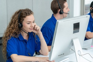 business people wearing headset working in office to support remote customer