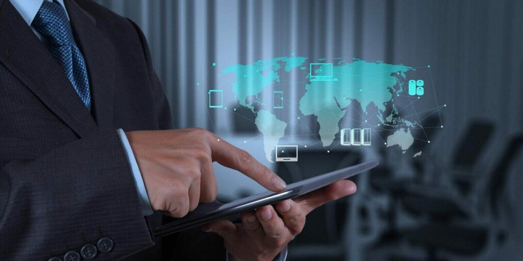 businessman hand using tablet computer and board room background