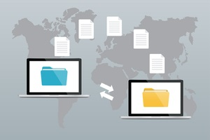 two laptops with folders on screen and transferred documents