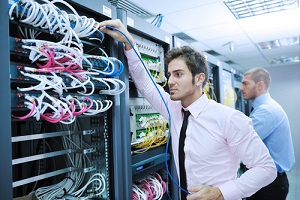 business people it engineer in network server room solving problems and give help and support