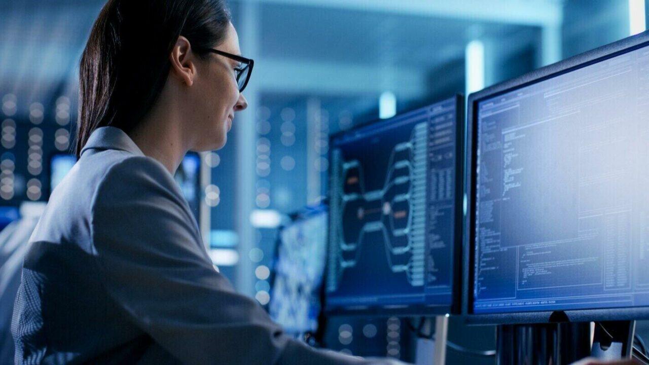 female it engineer working in monitoring room