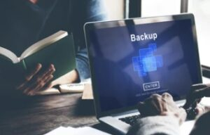 managed network services taking data backup using laptop