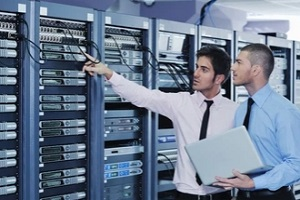two network engineers checking servers