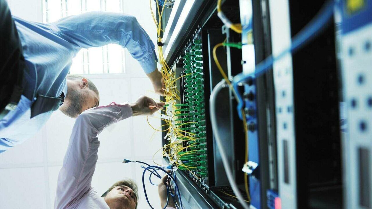 young business people it engineer in network server room